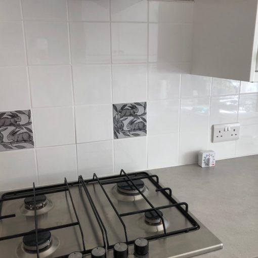 Kitchen with rabbit tiles